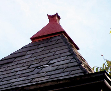 Finial-on-hexagonal-roof-to